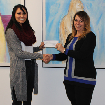 Megan Shott presenting SAPC cheque to Museum Director Donna Feledichuk